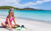 pic of flipper  - Little girl with flippers and goggles for swimming on the beach - JPG