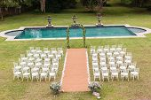 picture of lawn chair  - Wedding decor chairs ceremony lawn pool landscape - JPG