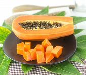 pic of pawpaw  - Slice papaya tropical fruit on green leaf