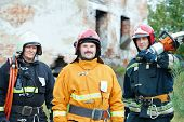pic of work crew  - firefighter crew in uniform in front of fire engine machine and fireman team - JPG