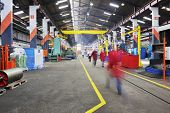 foto of factory-worker  - iron works steel and machine parts modern factory indoor hall - JPG