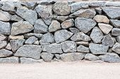 image of old stone fence  - Old stone wall made of big rocks - JPG