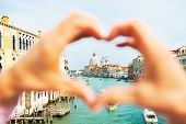 pic of piccolo  - Santa maria della salute venice italy framed by heart shaped hands - JPG