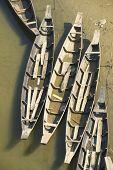 foto of bangladesh  - Old fishing boats at the river bank in Bandarban - JPG