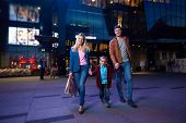 pic of mall  - happy family walking with paper bag in front of  shopping mall - JPG