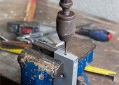 stock photo of hand drill  - drilling of metal with an old hand drill - JPG