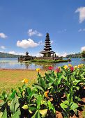 stock photo of hindu temple  - Floating Temple in Lake Bedugul or also known as Pura Ulun danu is a sacred Hindu temple and famous tourist attraction in Bali Indonesia - JPG