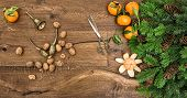 stock photo of walnut-tree  - orange mandarins walnuts and antique accessories - JPG