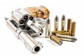 foto of revolver  - revolver and bullets on white background  - JPG