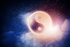 stock photo of yin  - Yin Yang sign in dark night sky - JPG