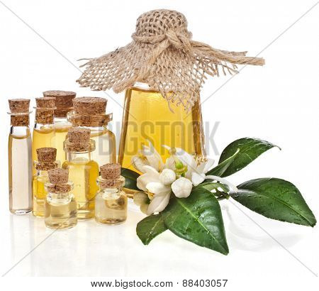 Herbal medicine or aromatherapy essential oil in bottles with fresh citrus flowers isolated on white background