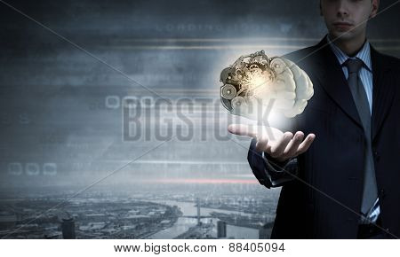 Close up of businessman holding human brain in hand