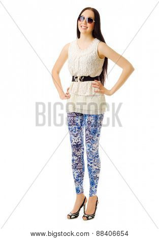 Young girl in blue pants isolated