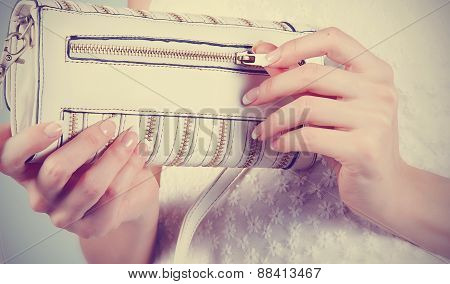 Female Hands With Manicure With White Handbag