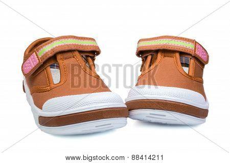 Pair Of Orange Child   Sneakers
