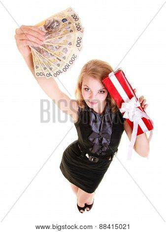 Woman Holds Christmas Gift Box And Polish Money. Holidays.