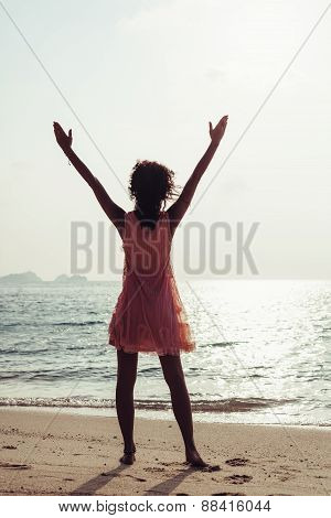Woman Enjoying Freedom Feeling Happy At Beach At Sunset