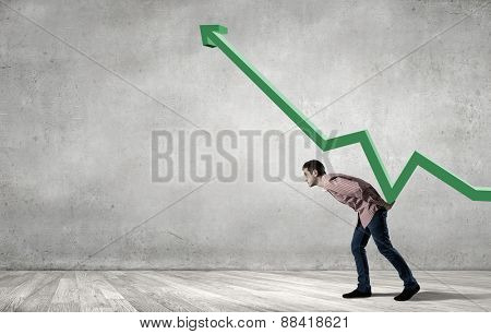 Young man in casual supporting increasing graph