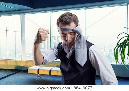 Angry businessman with a tie on his head