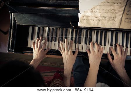 Man And Woman Are Playing Piano Together
