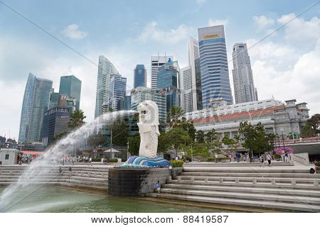 SINGAPORE - FEBRUARY 18, 2015: Waterfront views from the Merlion statue with vacationers people in the Merlion Park. Merlion Park a popular holiday destination with tourists and locals alike.