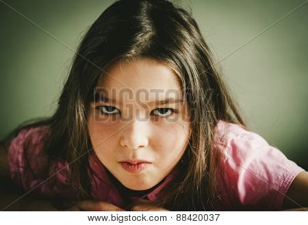 Toned portrait of a unhappy little girl .