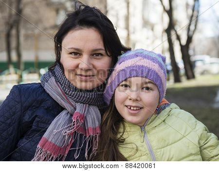 Mom and her daughter in the park.