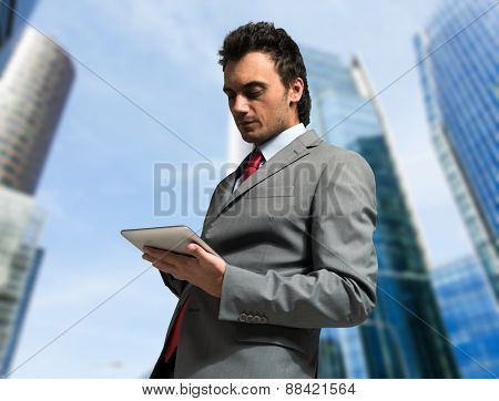 Portrait of a man using a digital tablet