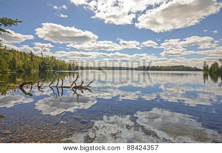 Cloud Reflections On A Calm Lake On A Sunny Fall Day