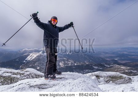 Man At The Summit Of A Mountain