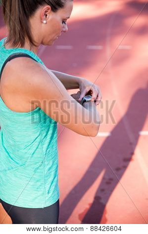 Close Up Image Of A Female Athlete Adjusting Her Heart Rate Monitor