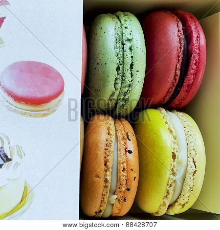colorful macarons in a box.
