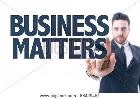 Business man pointing the text: Business Matters
