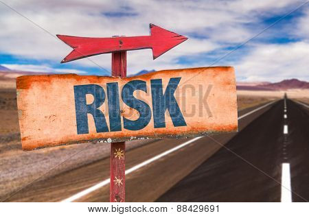 Risk sign with road background