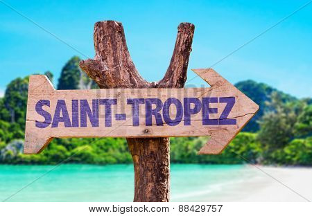 Saint-Tropez wooden sign with beach background