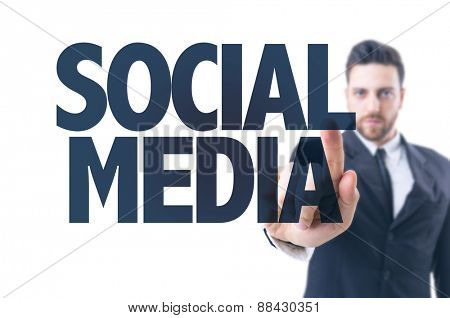 Business man pointing the text: Social Media