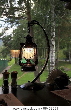 Kerosene lamp on the table in a Restaurant Beershale