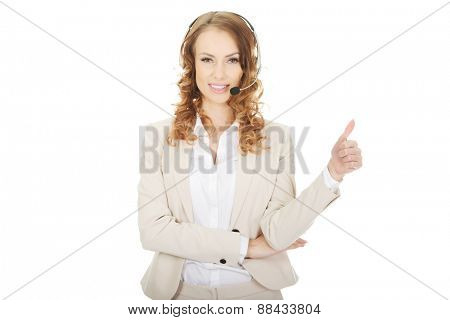 Happy call center woman with thumbs up.