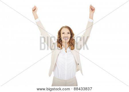 Beautiful successful businesswoman making fists.