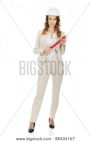 Businesswoman in hard hat with pencil.