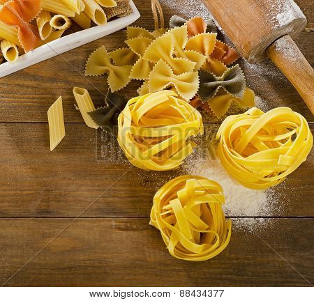 Uncooked Pasta   On A Old Wooden Background.