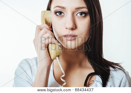 Woman doctor feeling sad on the phone because of bad news