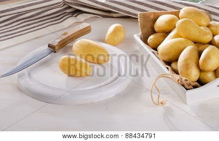 Fresh Organic Potatoes On  White Wooden Table