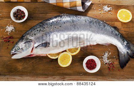 Atlantic Salmon  With Lemon On A Wooden Board