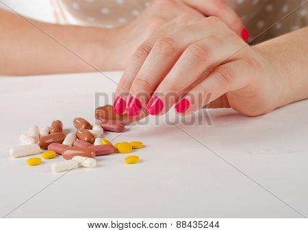 Young Woman Hand Holding  A Pill.