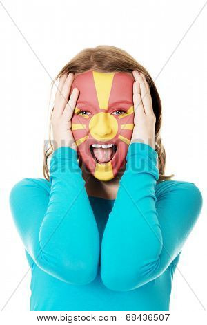 Woman with Macedonia flag painted on face.