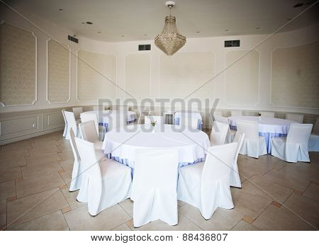 Empty white tables in a fashionable restaurant