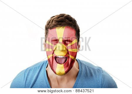 Screaming man with Macedonia flag painted on face.