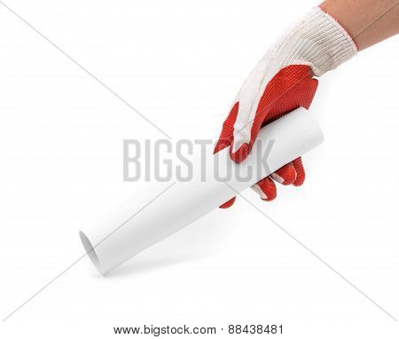 Hand in gray glove holding paper roll.