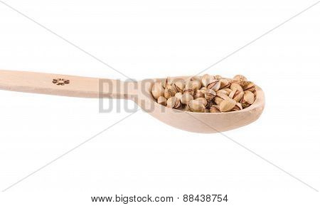 Spoon with pistachios.